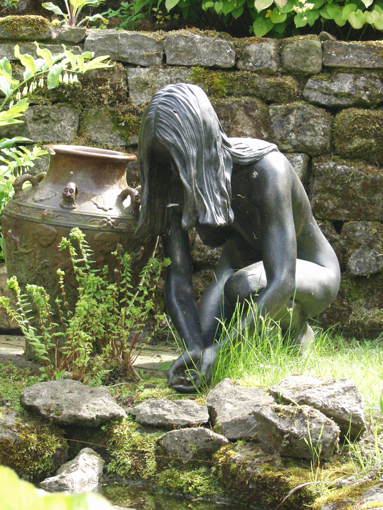Naked girl sculpture by pond