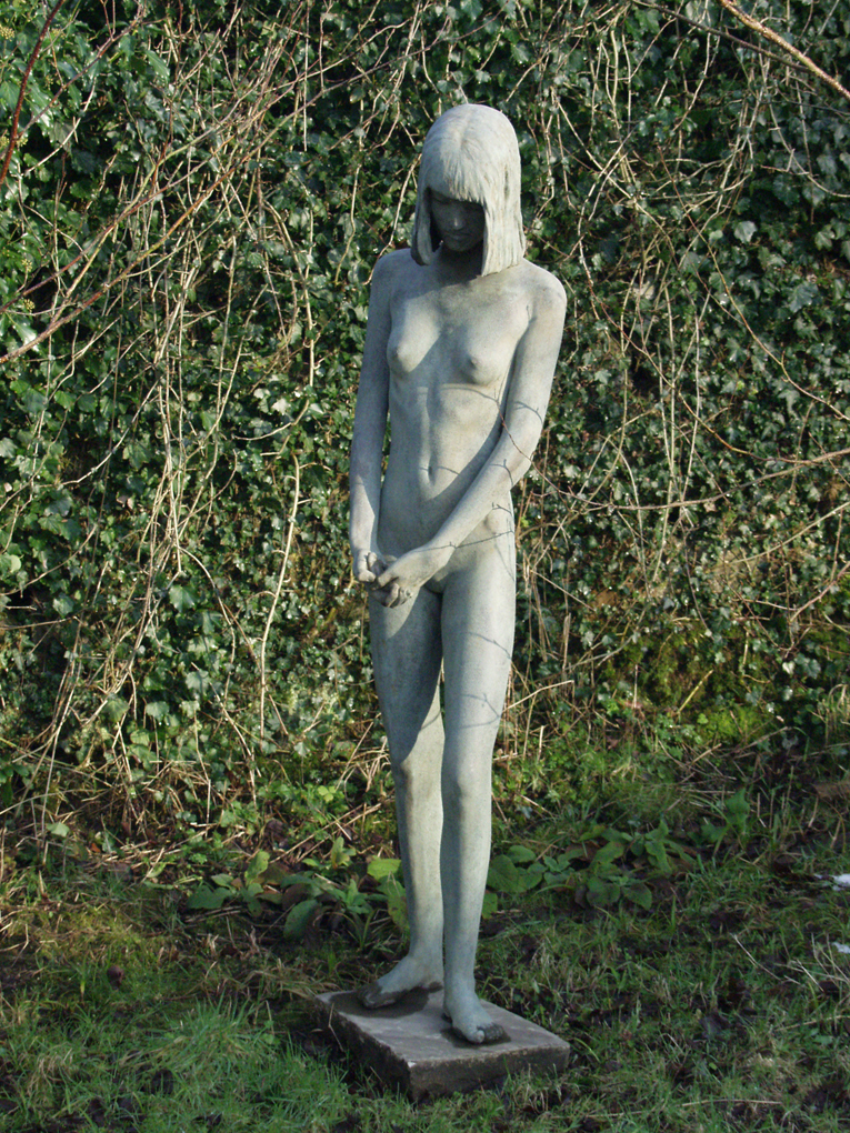 Young woman nude statue